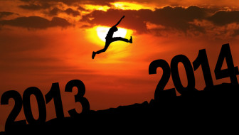 Amazing silhouette of man jumping at sunset toward 2014